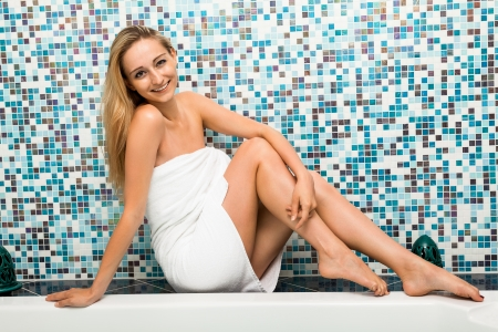 attractive blonde woman relaxing in jacuzzi whirlpool spa wellness healthcare photo