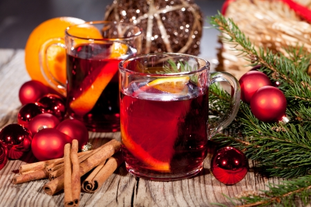 festive glitter christmas decoration bauble seasonal wintehot tasty spicy mulled red wine with orange and cinnamon christmas time winter