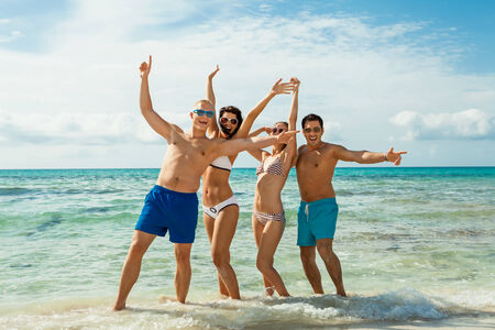 clique: young happy friends havin fun on the beach summer holidays lifestyle Stock Photo