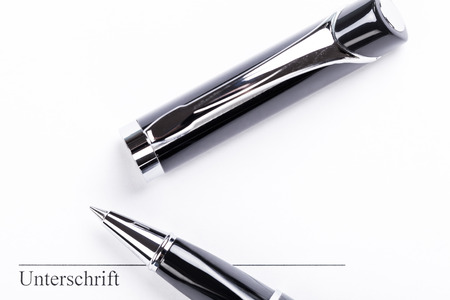 notieren: macro closeup sign document contract pen filler white background blank Stock Photo