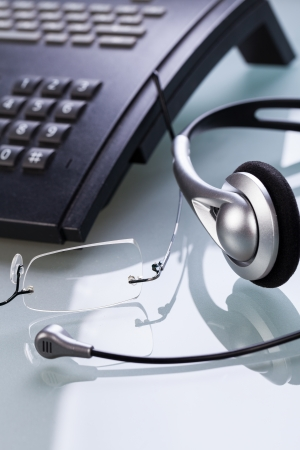 telephonic: working place office desk table headset glasses telephone objects business