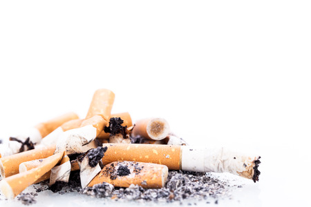 quit smoking: stop smoking cigarettes ashtrey nicotine closeup isolated object Stock Photo