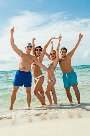young happy friends havin fun on the beach summer holidays lifestyle Фото со стока