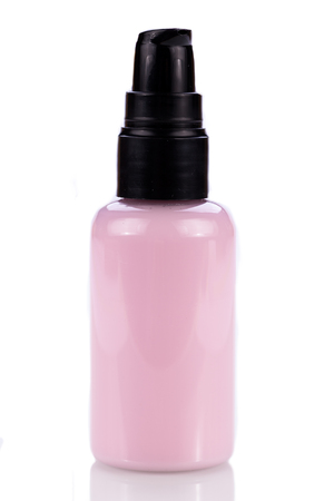 pink plastic bottle of cosmetic cream isolated on white product object photo