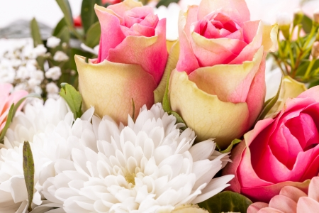 Bouquet of fresh pink and white flowers with a gerbera daisy, dahlia and roses in a close up view as a for celebrating Mothers Day, a birthday, anniversary, Valentines or a special occasion
