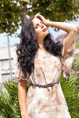 attractive brunette woman outdoor in summer sunshine relax lifestyle