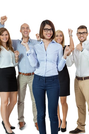 exultant: Successful business team of diverse young executives standing cheering and celebrating their success with an attractive young businesswoman or team leader in the foreground, on white