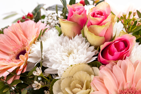 Bouquet of fresh pink and white flowers with a gerbera daisy, dahlia and roses in a close up view as a background for celebrating Mothers Day, a birthday, anniversary, Valentines or a special occasion