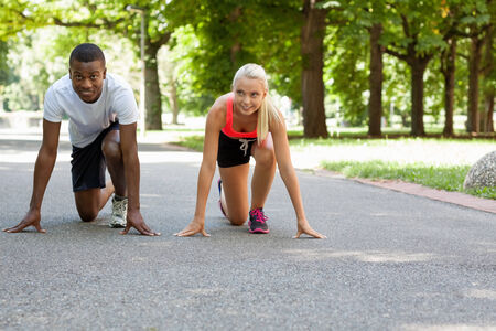 summer sport: young couple runner jogger in park outdoor summer sport lifestyle