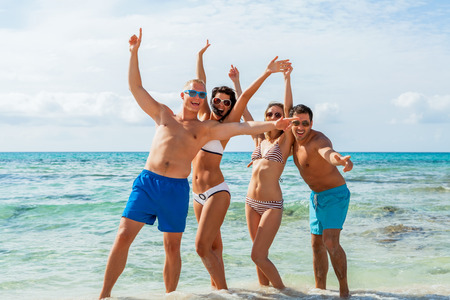 Young Happy Friends Havin Fun On The Beach Summer Holiday Photo