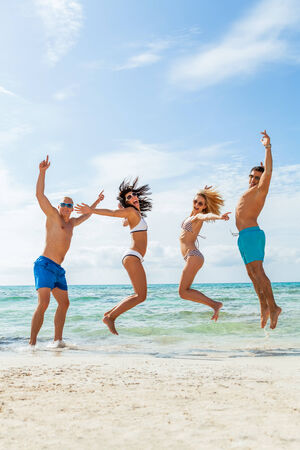 clique: young happy friends havin fun on the beach summer holiday Stock Photo