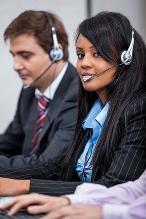 friendly callcenter agent operator with headset telephone support service  photo