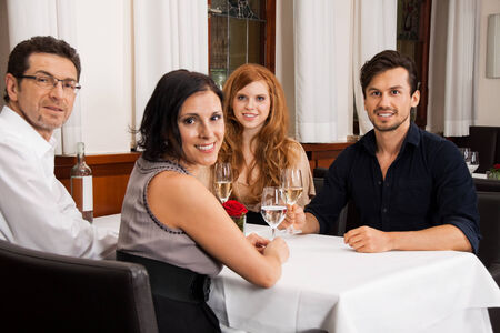 smiling happy people friends in restaurant for dinner  photo