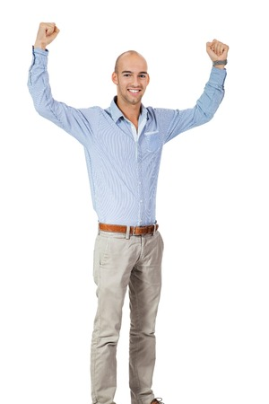 Man cheering in jubilation to celebrate an achievement or success raising his fists and punching the air, isolated on white photo