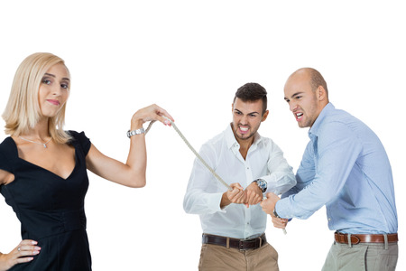 nonchalant: Beautiful strong fit woman demonstrating her dominance in a tug of war with two men pulling as hard as they can on the end of a rope she is holding while she remains nonchalant and glamorous, on white Stock Photo