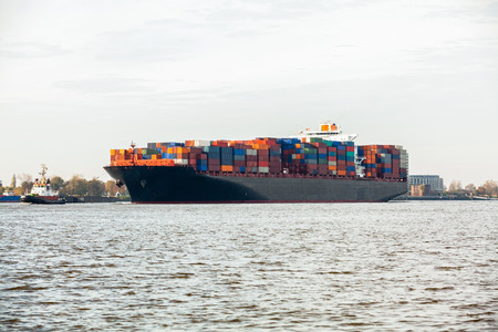Fully laden container ship in port with its decks stacked with metal containers full of freight and cargo for international destinations Stock Photo - 25587351