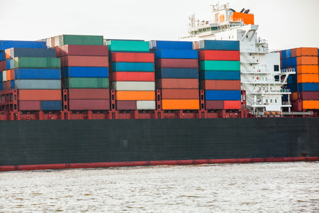 Fully laden container ship in port with its decks stacked with metal containers full of freight and cargo for international destinations Stock Photo - 25587360
