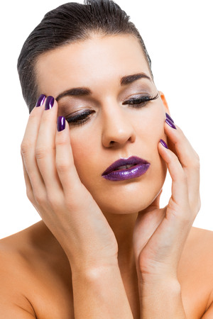 Graceful attractive woman with purple lips and nails portrait isolated photo