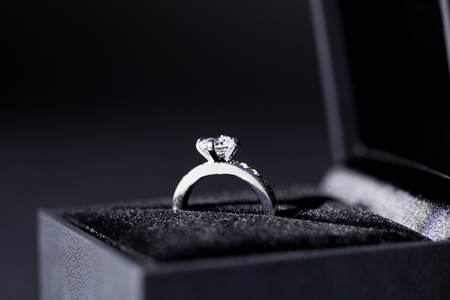 diamond rings: Close-up of a jewelry box with two elegant silver rings from which one with a diamond, symbol of engagement and elegance