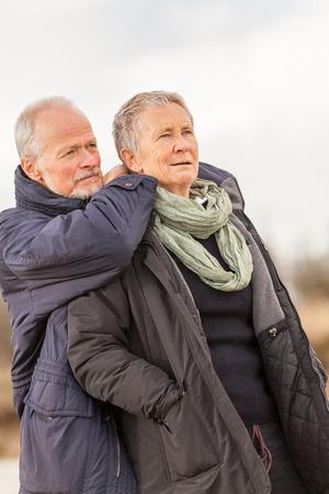 vivacious: happy senior couple elderly people together outdoor in autumn winter Stock Photo