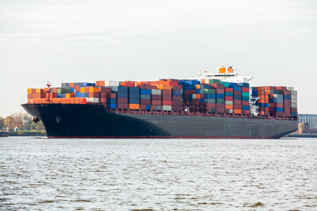 Fully laden container ship in port with its decks stacked with metal containers full of freight and cargo for international destinations Stock Photo - 25977129