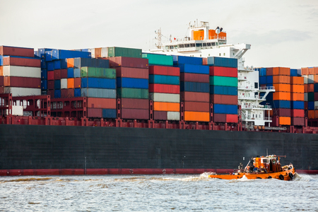 Fully laden container ship in port with its decks stacked with metal containers full of freight and cargo for international destinations Stock Photo - 25977130