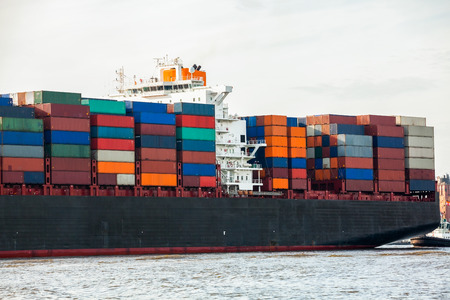 Fully laden container ship in port with its decks stacked with metal containers full of freight and cargo for international destinations Stock Photo - 25977131