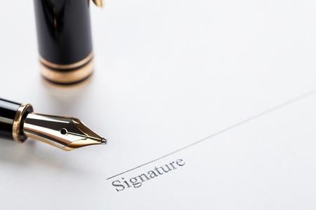 macro closeup sign document contract pen filler white background blank Фото со стока