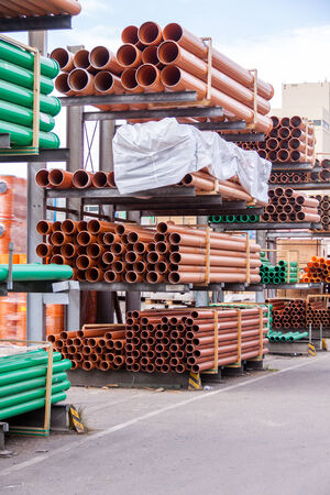 diameters: Plastic pipes stacked in a factory or warehouse yard for use in plumbing or sewage installations on a construction site Stock Photo