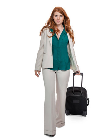 pantsuit: Confident business woman walking while carrying luggage Stock Photo
