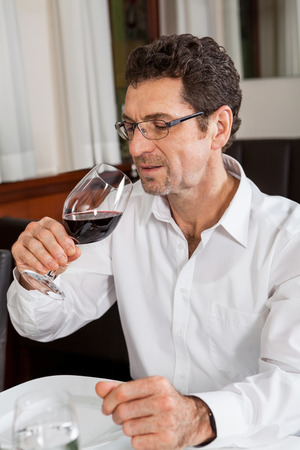 accommodating: Waiter happily accommodating couple with a big smile on his face Stock Photo