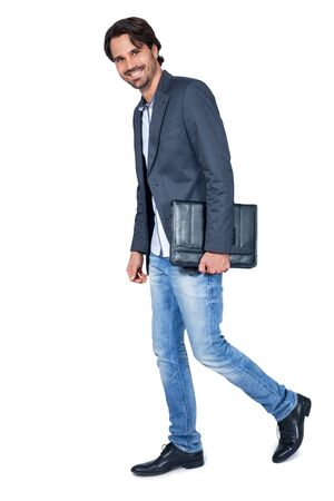 trustful: Handsome stylish bearded young man carrying a briefcase looking to his side with a friendly smile, isolated on white