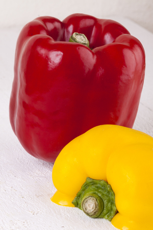 lycopene: Red and Yellow Peppers on White Wooden