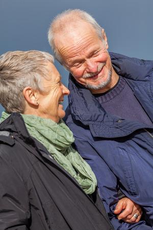 happy elderly senior couple walking on beach healthcare recreation photo