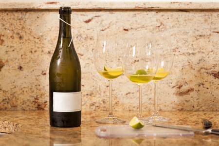 hugo: White Wine Bottle with Two Garnished Glasses of Wine