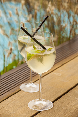 hugo prosecco elderflower soda ice summer drink outdoor aperitif photo