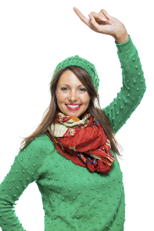 exuberant: Excited exuberant pretty young woman cheering and smiling and raising her hands in the air with a joyful expression, isolated on white