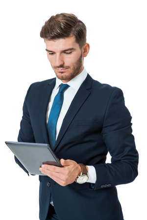 navigating: Businessman using a tablet computer navigating the touchscreen with his finger as he surfs the internet, close up view of his hands and the tablet, on white