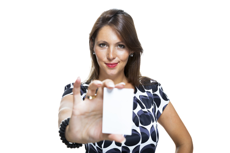 credentials: Portrait of Smiling Long Hair Woman in Nice Printed Dress Holding her Name Tag While Looking at the Camera. Isolated on White Background.