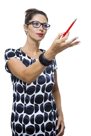 quizzical: Portrait of Serious Woman with Eyeglasses, Wearing a Printed Dress, Holding a Red Ballpoint Pen. Captured in Studio with White Background.