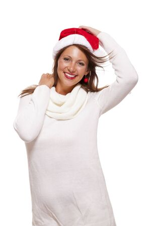endorsing: Young woman in a Santa hat holding out her hands with her empty palms upwards for placement of your Christmas and seasonal products, isolated on white with copyspace