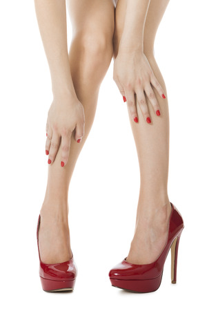 flawless: Flawless Woman Legs in Elegant Red High Heel Shoes, Isolated on White Background.