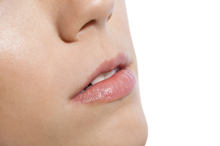 sensuous: Close up pink lips of a woman on white  Stock Photo