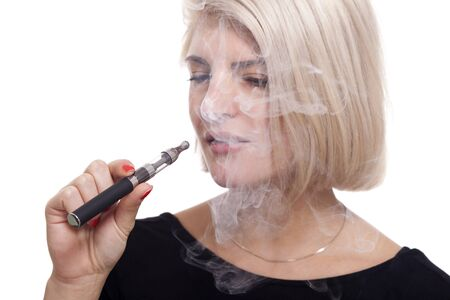 e cigarette: Close up Serious Facial Expression of a Young Blond Woman Smoking Using E- Cigarette on a White  Stock Photo