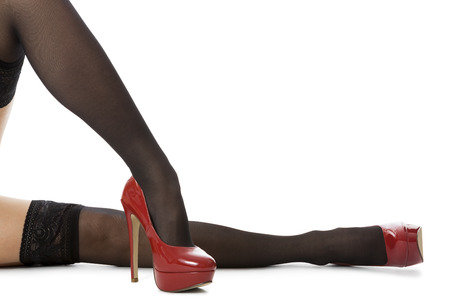 black stockings: Flawless legs woman in elegant red high heel shoes, isolated on white .