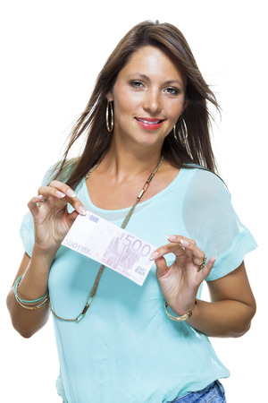 materialist: Smiling Attractive Young Woman in Light Blue Green Trendy Shirt Holding a 500 Euro Bill While Looking at the Camera. Isolated on White Background.