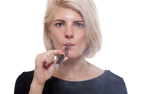 Close up Serious Facial Expression of a Young Blond Woman Smoking Using E- Cigarette on a White Background photo