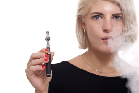 background e cigarette: Close up Serious Facial Expression of a Young Blond Woman Smoking Using E- Cigarette on a White Background Stock Photo