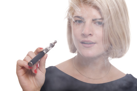 e cigarette: Close up Serious Facial Expression of a Young Blond Woman Smoking Using E- Cigarette on a White Background Stock Photo