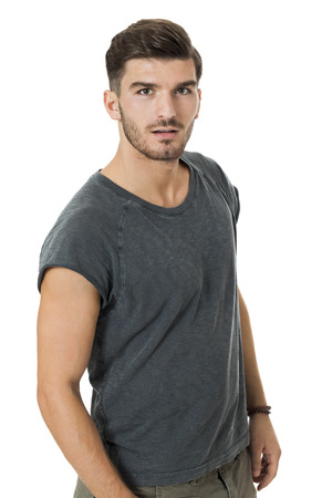 charismatic: Handsome young bearded man with a lovely charismatic smile wearing a cotton t-shirt, isolated on white